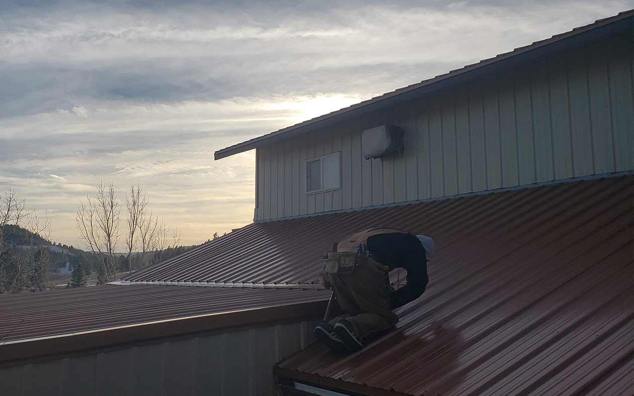 Raintite's crew member working at sunset